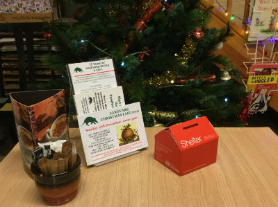 Shelter Box on Aardvark Cafe table by Christmas Tree